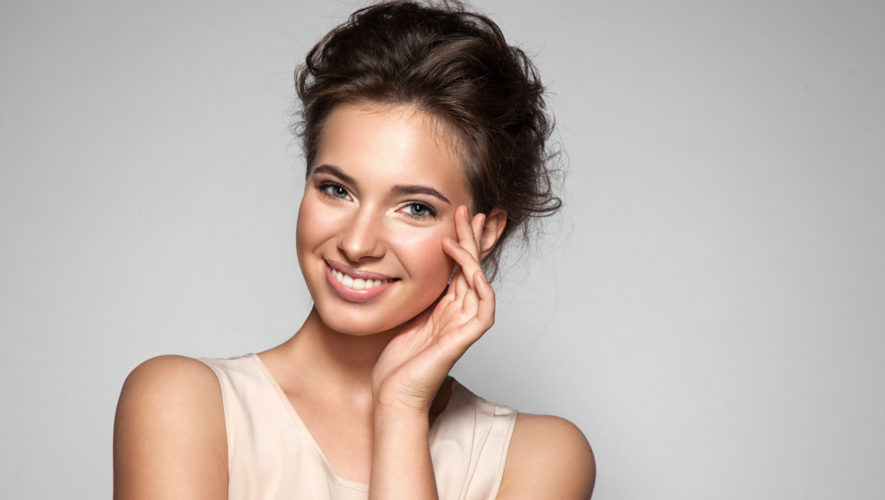 Portrait of young woman with perfect skin clean with natural make-up