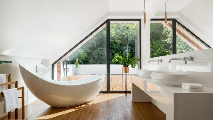 Elegant attic bathroom with bathtub
